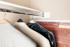Three suits hanging in a cedar closet Royalty Free Stock Photos