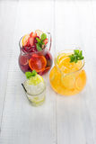 Three summer lemonade on a white wooden background Royalty Free Stock Image