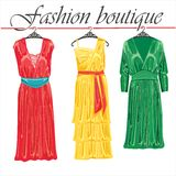 Three summer silk dresses.Fashion boutique Royalty Free Stock Images