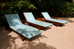 Three sun beds in trees shadow (in HiRes) Royalty Free Stock Photos