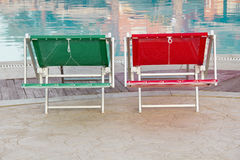 Three sunbeds near the swimming pool Royalty Free Stock Photo