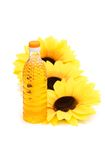 Three sunflowers and bottle stock images