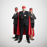 Three superheroes in formal wear Stock Image