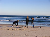Three surfers. Getting ready for the water Royalty Free Stock Photos