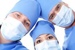 Three surgeon's heads looking at camera Royalty Free Stock Photo