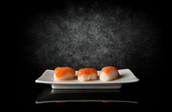 Three sushi on black Stock Photo