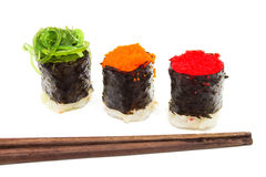 Three Sushi with Chopsticks. Royalty Free Stock Images