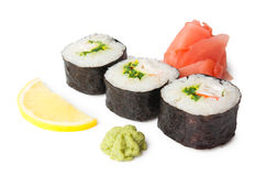 Three sushi, wasabi, gringer and lemon Royalty Free Stock Photography