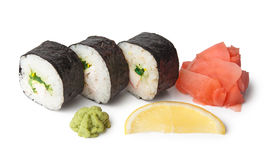 Three sushi, wasabi, gringer and lemon Stock Photography