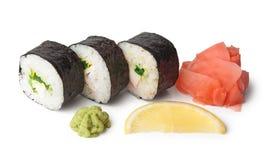Three sushi, wasabi, gringer and lemon Stock Photography