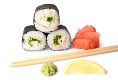 Three sushi, wasabi, gringer, lemon and sticks Royalty Free Stock Photo