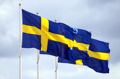 Three Sweden flags. In the sky Stock Image