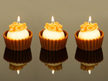 Three sweet aroma candles Stock Images