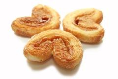 Three sweet cookies on white background Stock Photos