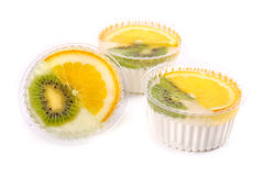 Three sweet desserts with a kiwi and lemon Royalty Free Stock Photography