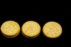 Three sweet  good round cookie`s. A cookie is a baked or cooked food that is small, flat and sweet. It usually contains flour, sugar and some type of oil or fat Stock Photography