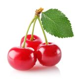 Three sweet juicy cherry with green leaf Stock Photos
