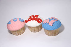 Three sweet mastic cupcake on white. Background Stock Photos
