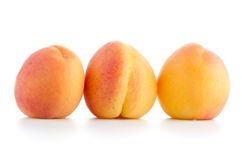 Three sweet peaches Stock Photos