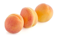 Three sweet peaches Royalty Free Stock Images