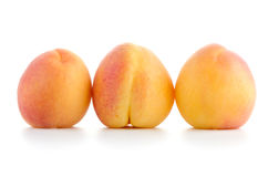 Three sweet peaches Stock Image