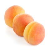 Three sweet peaches Stock Photo