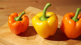 Three sweet peppers on a board stock video footage