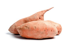 Three sweet potatoes. Isolated on white background Royalty Free Stock Photos