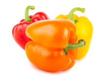 Three sweet red, orange, and yellow peppers Stock Photo