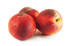 Three sweet ripe peaches Royalty Free Stock Images