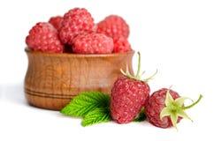 Three sweet ripe raspberries Stock Images