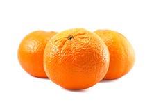 Three sweet tangerines. Sweet mandarins isolated on white Royalty Free Stock Image