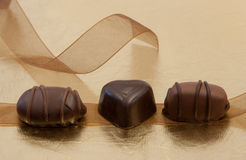 Three Sweet Treats. With Brown Ribbon Stock Images