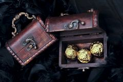 Three sweets in small open treasure chest Royalty Free Stock Photos