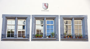 Three Swiss windows Royalty Free Stock Photos