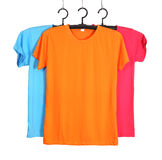 Three t-shirt template on hange isolated on white Stock Photo