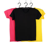 Three t-shirt template on hange isolated on white Royalty Free Stock Photos