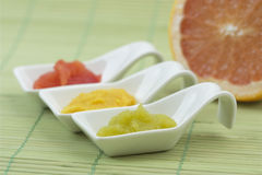 Three tablespoons. Of mashed fruit colorful Stock Image