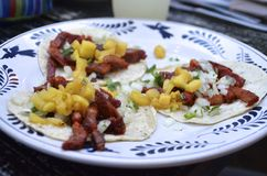 Three tacos al pastor on corn tortillas Royalty Free Stock Images