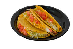 Three tacos on black plate royalty free stock photography