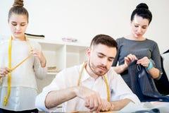 Three tailors work Stock Photos