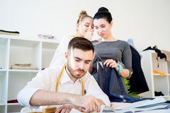 Three tailors work Stock Images