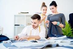Three tailors work Royalty Free Stock Image