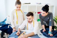 Three tailors work Royalty Free Stock Images