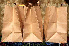 Three takeaway food packages Stock Images