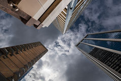 Three tall buildings upright. Three tall skyscrapers viewed from bottom looking up Royalty Free Stock Photography