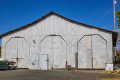 Three Tall Doors At Railroad Maintenance Yard Building. Three Tall Doors On Vintage Railroad Maintenance Building stock images