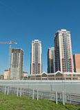 Three tall houses, stretching into the sky. Construction in the Royalty Free Stock Photo