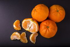 Three tangerines on dark background Royalty Free Stock Images
