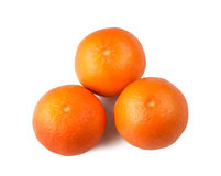 Three tangerines on a white background. Three orange mandarins isolated on white background Stock Images